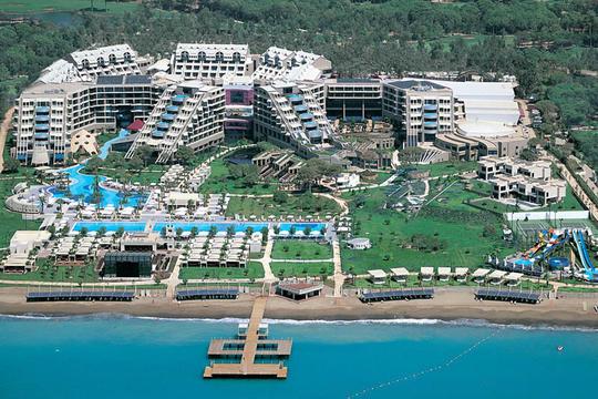 https://media.costalessgolf.com/2015/04/susesi-deluxe-resort-outside.jpg
